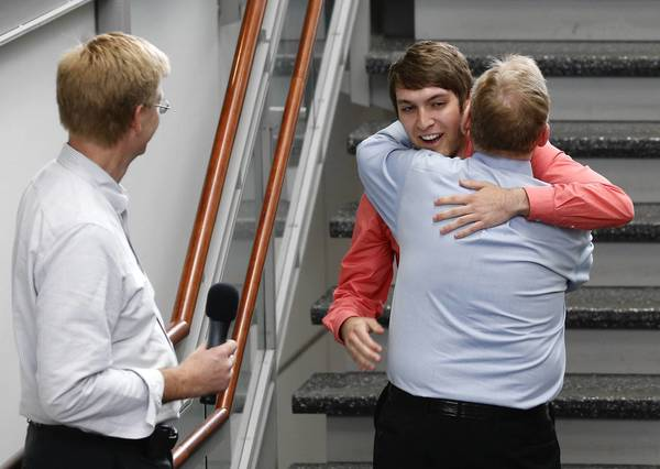 Burr Ridge resident Tom Murphy greets German college student and bone marrow donor Manuel Auge on Sunday at Loyola University Medical Center's Cardinal Bernardin Cancer Center in Maywood. At left is Murphy's physician, Dr. Patrick Stiff, who performed the transplant.