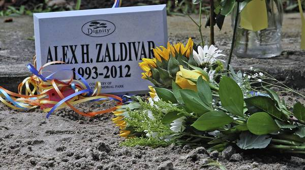 The Zaldivar family moved their son's casket on his birthday from a temporary location at Woodlawn Cemetery to a final resting place within the cemetery.