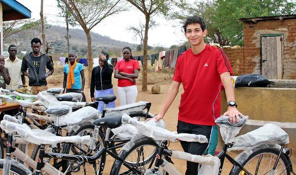 Sebouh Bazikian, a senior at St. Francis High School in Glendale, poses with the 43 new bicycles he helped purchase for donation to the Machao Orphanage in Makueni County, Kenya, about 115 miles from the country's capital of Nairobi.