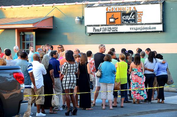 "Patrons line up outside the Georgia Boy Cafe at Park Circle in Hagerstown on Sunday evening for the unveiling of the renovations made over the weekend by ""Restaurant: Impossible"" crew."