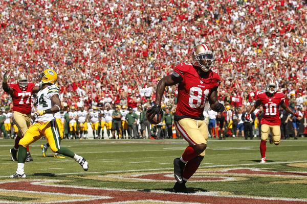 49ers wide receiver Anquan Boldin catches a touchdown pass against the Packers in the second quarter.
