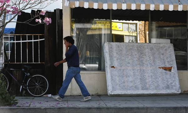 Supporters of a bill to create a state recycling program for mattresses and box springs say the proposal would combat urban blight. Above, a discarded mattress in front of a vacant store in Wilmington in March.