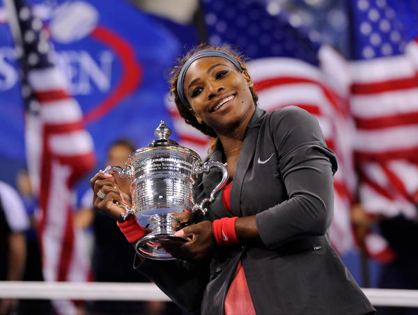 Serena Williams poses with the championship trophy.