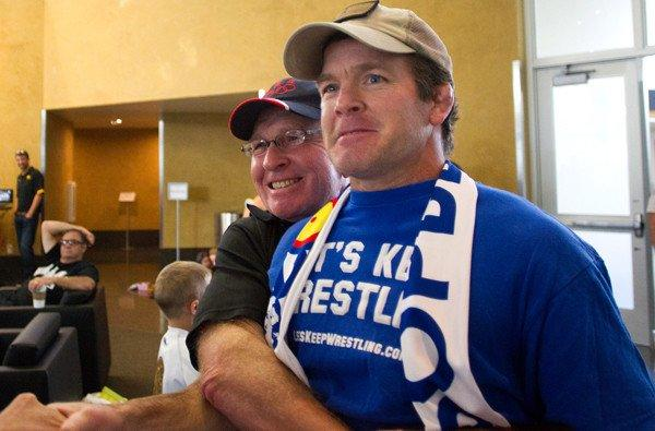 Wrestling legend Dan Gable, left, lifts Iowa associate head coach Terry Brands after the International Olympic Committee voted to to reinstate wrestling for the 2020 Olympics.