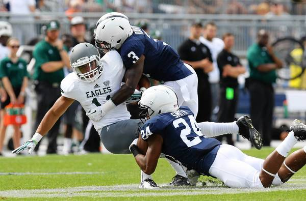 Eastern Michigan running back Tyler Allen (11) is tackled by Penn State cornerbacks Da'Quan Davis (3) and Anthony Smith during the fourth quarter at Beaver Stadium.