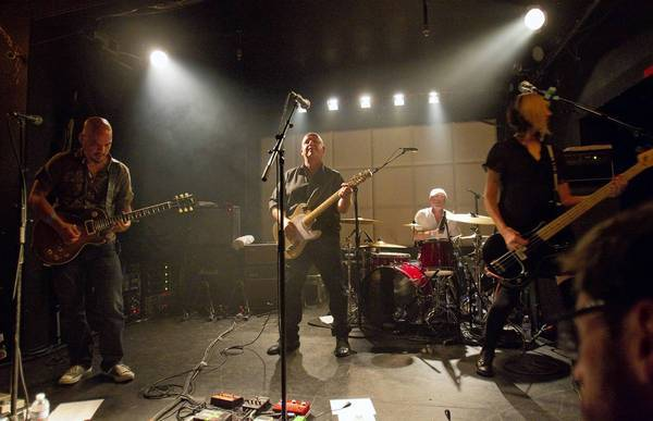 The Pixies lead guitarist Joey Santiago, from left, singer Black Francis, drummer David Lovering and bassist Kim Shattuc perform at the Echo in Los Angeles on Sept. 6, 2013.