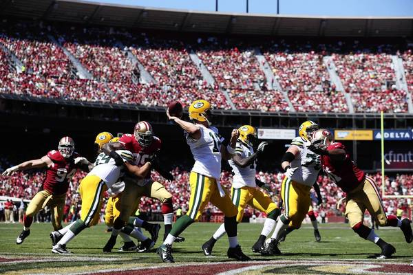 Packers quarterback Aaron Rodgers passes the ball in the first quarter during the game against the San Francisco 49ers at Candlestick Park on Sunday.