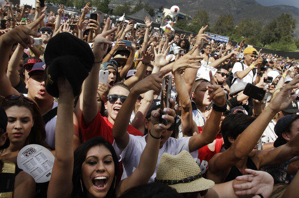Fans cheer on performers on Day 1 of Rock the Bells at San Manuel Amphitheater in San Bernardino on Sep. 7, 2013.