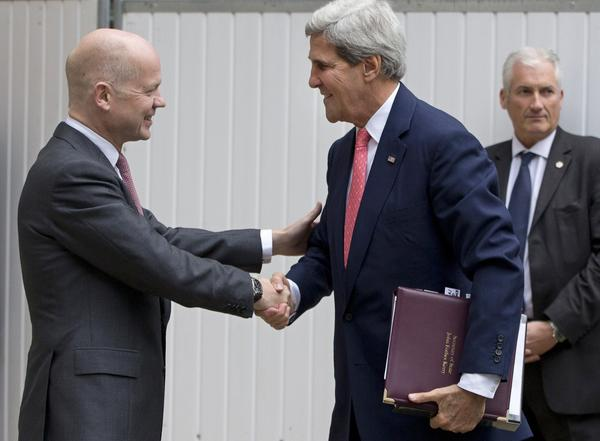 British Foreign Secretary William Hague, left, welcomes Secretary of State John Kerry to the Foreign Office in London.