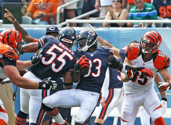 Charles Tillman (33) intercepts a pass in the second quarter Sunday.