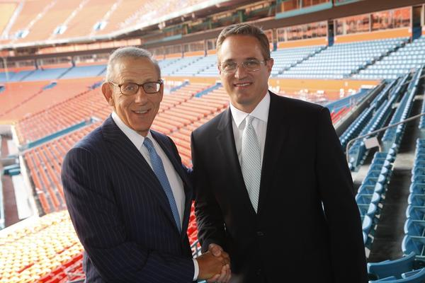 Miami Dolphins owner Stephen Ross, left, welcomes new president and CEO of the Dolphins and Sun Life Stadium Tom Garfinkel.
