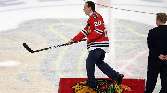New Northwestern mens basketball coach Chris Collins tries his hand at hockey during game between the Chicago Blackhawks and Dallas Stars at the United Center April 15.