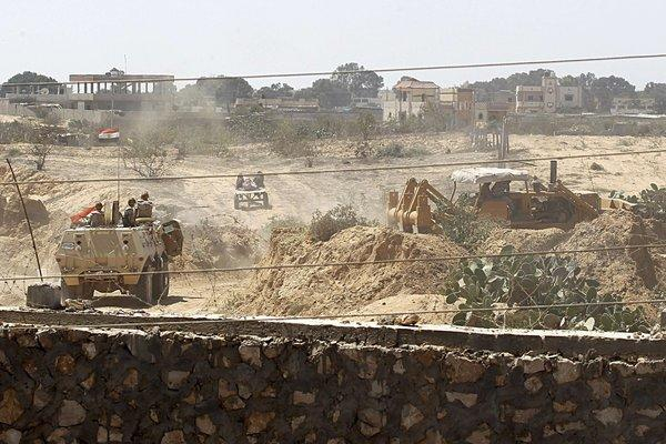 Egyptian soldiers use bulldozers to search for tunnels on the border with the Gaza Strip on Sunday.