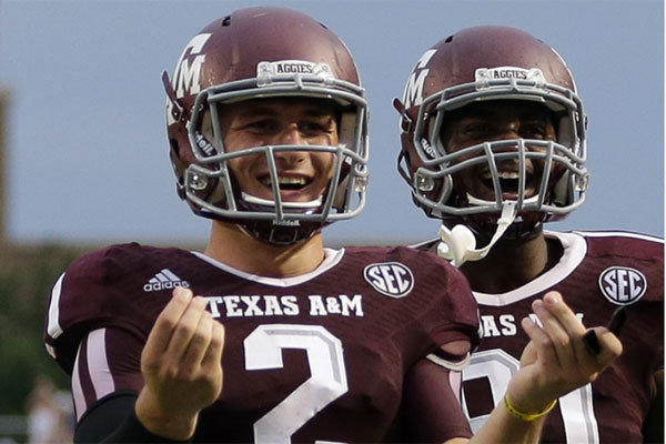 Texas A&M quarterback Johnny Manziel celebrates after throwing a touchdown pass against Sam Houston State on Saturday.