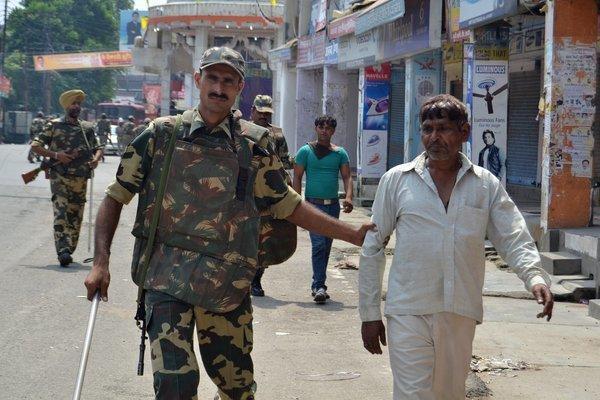 Indian soldiers detain two men following riots between Muslims and Hindus in Muzaffarnagar in Uttar Pradesh state.