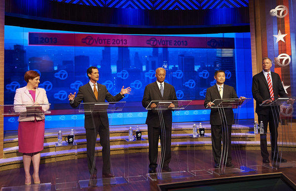 Anthony Weiner, second from left, responds to a question during a debate with four of his rivals in the Democratic primary.