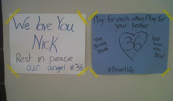 Handmade signs for UCLA receiver Nick Pasquale, who died after being hit by a car, were on display outside the Bruins' practice facility.