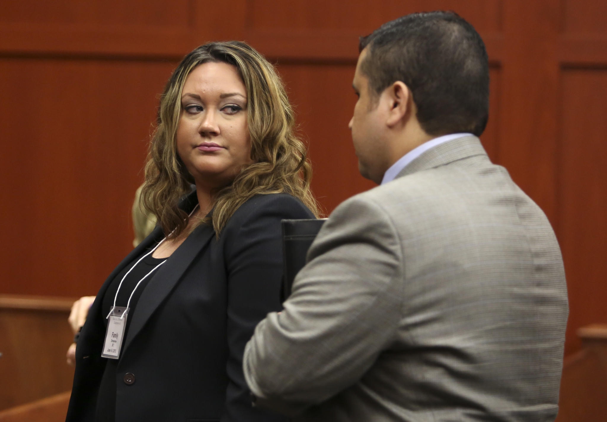 Shellie Zimmerman looks at her husband George Zimmerman as they leave the court room during a recess in Zimmerman's trial in Seminole circuit court in Sanford, Fla., Friday June 14, 2013.