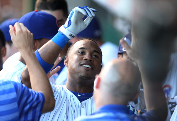 Luis Valbuena is congratulated in the dugout after hitting a home run in July.