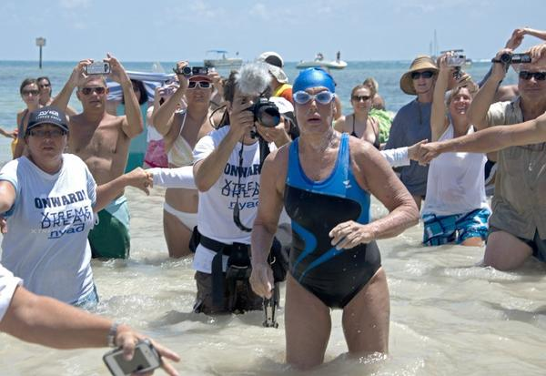 Diana Nyad emerges from the Atlantic Ocean after completing the swim from Cuba to Florida.
