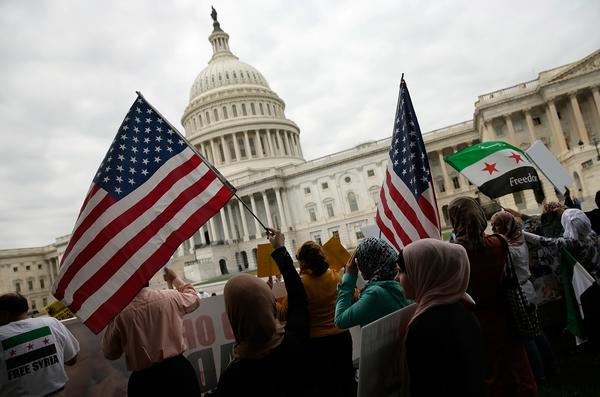 Syrian American protesters gather outside the U.S Capitol on Monday, urging Congress to support President Obama's call to strike Syria for using chemical weapons against its own people.
