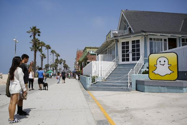 People take pictures in front of Snapchat's Venice headquarters in August.