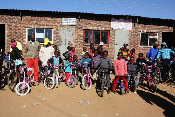 Children line up for a cycling event organized by the Lesotho Cycling Association.
