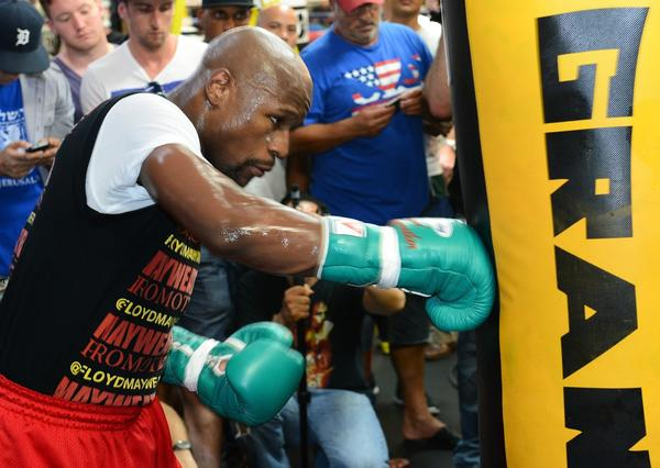Floyd Mayweather Jr. hits a heavy bag as he works out at the Mayweather Boxing Club on Aug. 28 in Las Vegas.