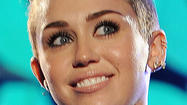 Miley Cyrus' latest shock treatment: Straddling a 'Wrecking Ball'