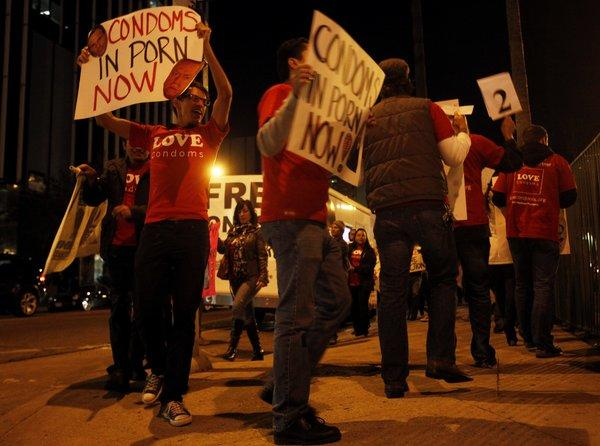 AIDS Healthcare Foundation members protest about a half a block from the XBiz Awards at the Palladium in Los Angeles in 2011.