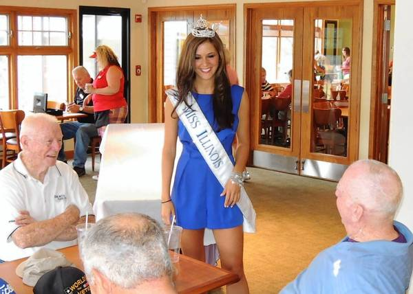 Miss America competitor Brittany Smith, Miss Illinois 2013, talks with golfers before a recent Elmhurst Chamber of Commerce golf outing.