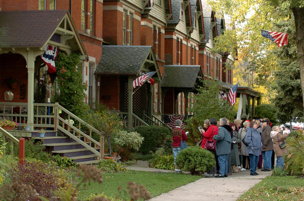 Looking West down 112th Street ( Arcade Row) at the corner of St. Lawrence as visiting folks from Bensonville and Elmhurst Park District's taking part in the Pullman House Tour in 2009.