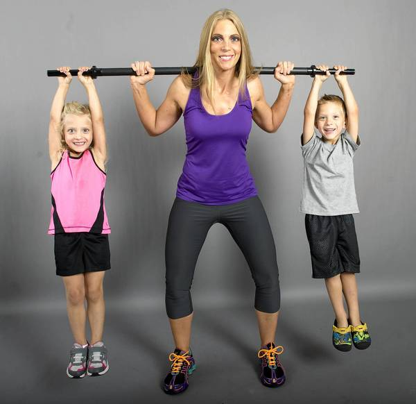 Workout Achiever: Stacy Menecola, 32, Northampton. On the bar are her children Gianna and Dominic, both age 4