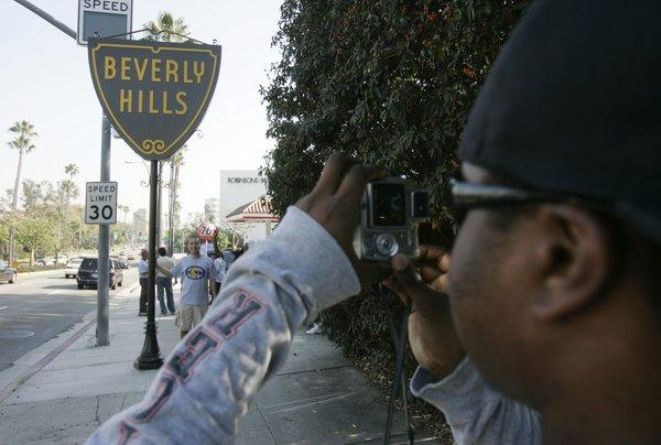 Snapping a photo in front of the Beverly Hills sign.