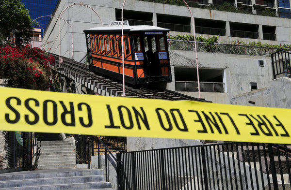 Caution tape reminds the public to stay away from the closed Angels Flight after rail car Sinai jumped the tracks last week.