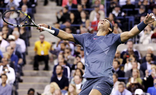 Rafael Nadal reacts after winning the final point in a four-set victory over Novak Djokovic in the men's championship match at the U.S. Open on Monday night.