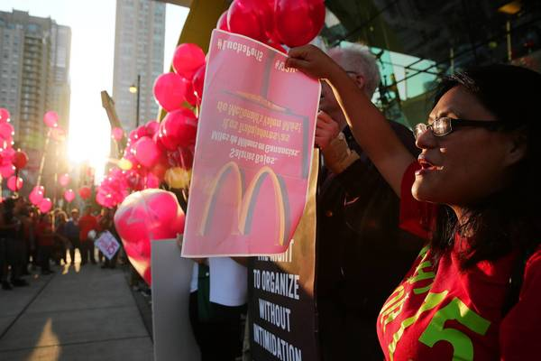 Ariadna Salgado rallies with protesters in August in Chicago, calling for higher wages and better working conditions for fast-food and retail workers.