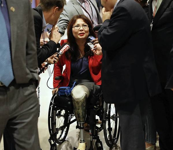 Rep. Tammy Duckworth of Illinois, a veteran of the war in Iraq, arrives for a closed intelligence briefing on Syria for members of Congress on Monday.