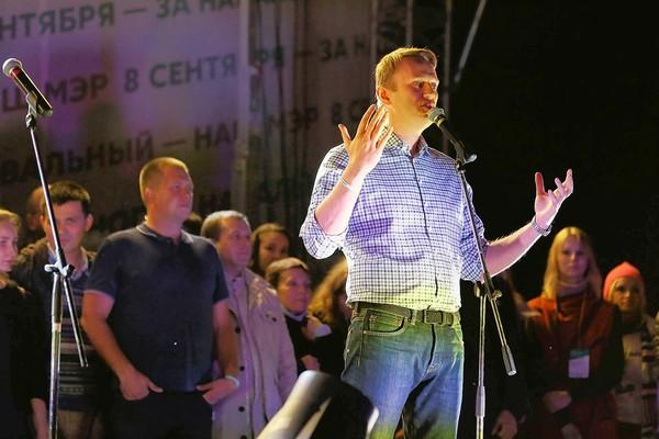 Opposition leader Alexei Navalny addresses thousands of his supporters at a downtown Moscow rally Monday night protesting alleged electoral fraud in Sunday's mayoral election.