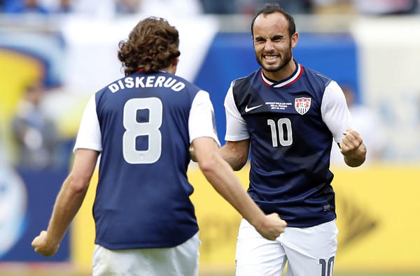Landon Donovan and Mikkel Diskerud celebrate after a victory over Panama in the Gold Cup.