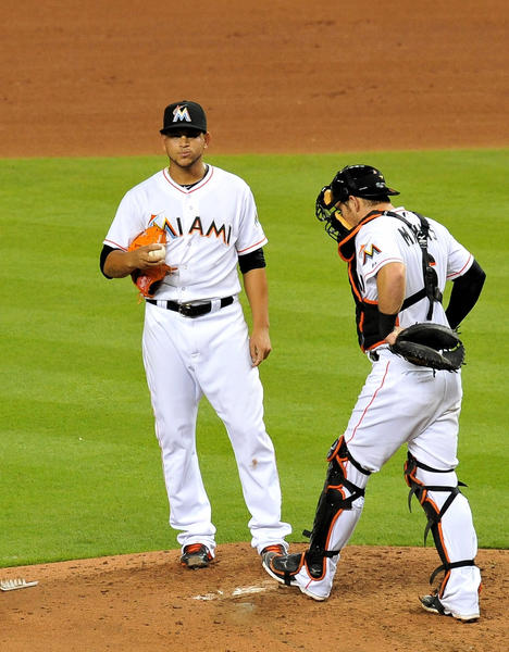 Sep 9, 2013; Miami, FL, USA; Miami Marlins starting pitcher Henderson Alvarez (left) talks with catcher Jeff Mathis (right) on the pitching mound during the fourth inning against the Atlanta Braves at Marlins Park. Mandatory Credit: Steve Mitchell-USA TODAY Sports ORG XMIT: USATSI-124606