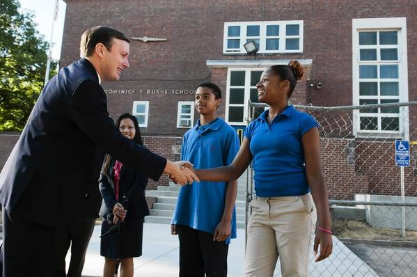 U.S. Sen. Chris Murphy meets with Scarlett Wong of the Burns Latino Studies Academy and students Kassandra Grant and Joel Oyola before a meeting at Burns to discuss chronic absenteeism.