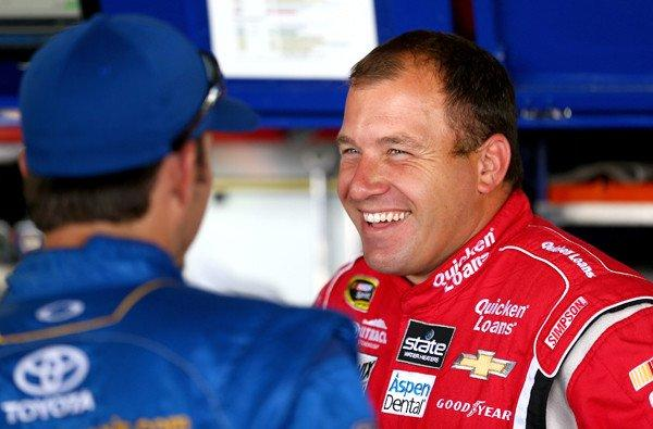NASCAR driver Ryan Newman, right, chats with Martin Truex Jr. in the garage area during practice at Richmond International Raceway on Friday.