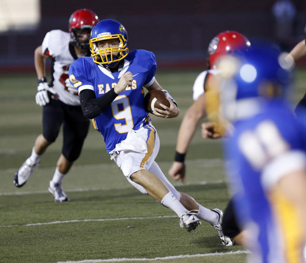 Aberdeen Central's Jacob Goehring (9) finds some room to run during the first half of Friday night's game against Brookings at Swisher Field. American News Photo by John Davis