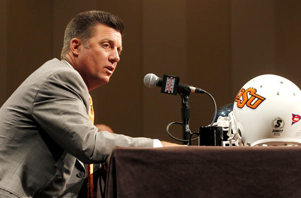 Oklahoma State Coach Mike Gundy, a former quarterback for the Cowboys, has been head coach since 2005. He returned to his alma mater in 2001 as an assistant.