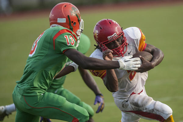 Deerfield Beach's Aeron McNeal, gets past Blanche Ely's Terrance Henley Jr. for a touchdown against Blanche Ely.