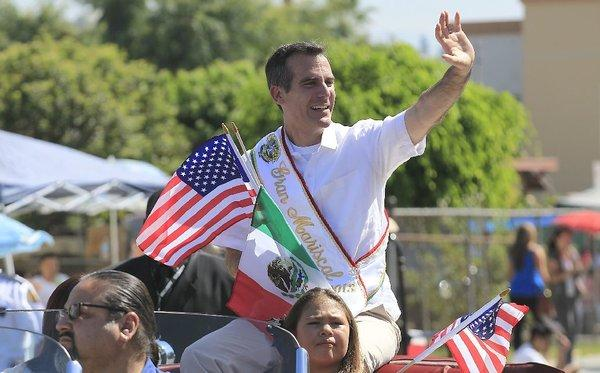 Los Angeles Mayor Eric Garcetti, seen here on Sunday as the grand marshal of the Mexican Independence Day Parade in East Los Angeles, picked a former USC dean to head City Hall's Office of Immigrant Affairs.