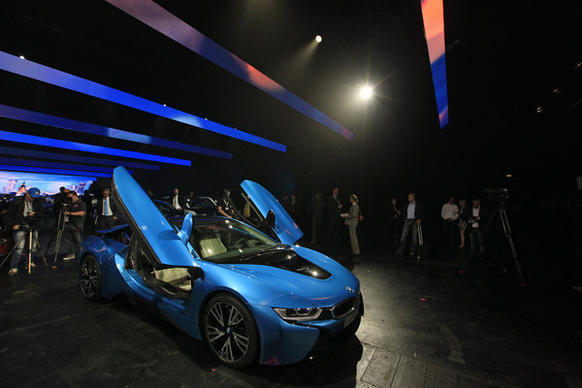 Visitors look at the new BMW i8 plug-in hybrid after it was launched at the 65th Frankfurt Auto Show.