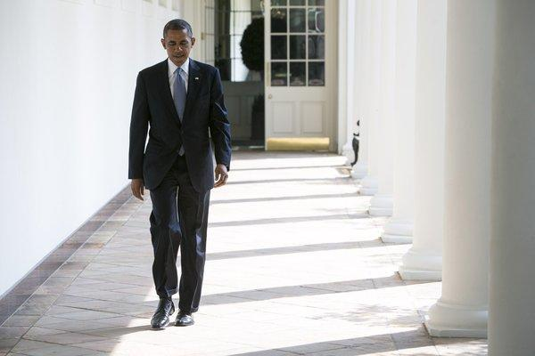 President Obama walks to the Oval Office on Tuesday.