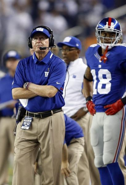 New York Giants head coach Tom Coughlin watches the clock during the fourth quarter of the game against the Dallas Cowboys at AT&T Stadium. Dallas beat New York 36-31.